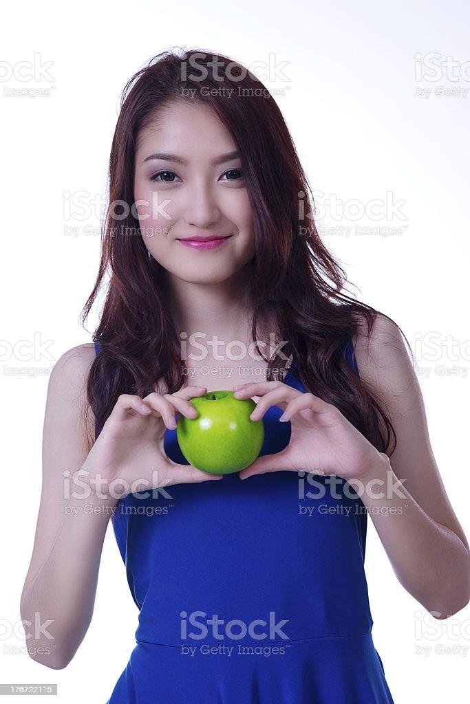 Beautiful asian woman with apple stock photo