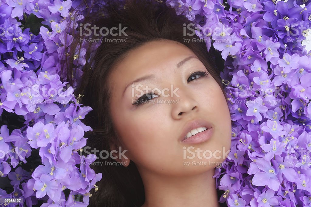 beautiful Asian woman with flowers royalty-free stock photo