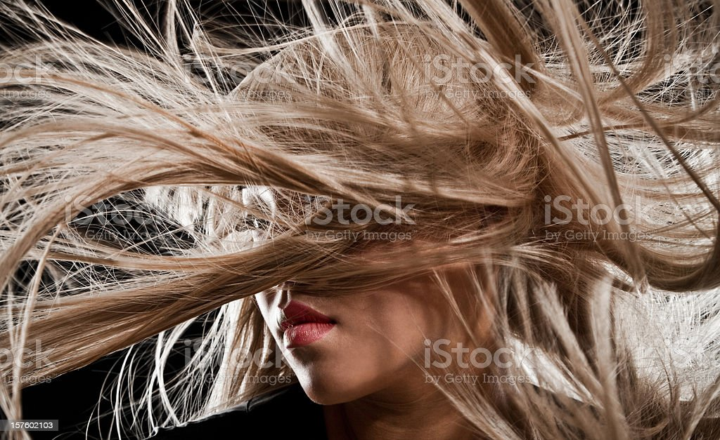 Beautiful Asian Woman with Long Blonde Blowing Hair royalty-free stock photo