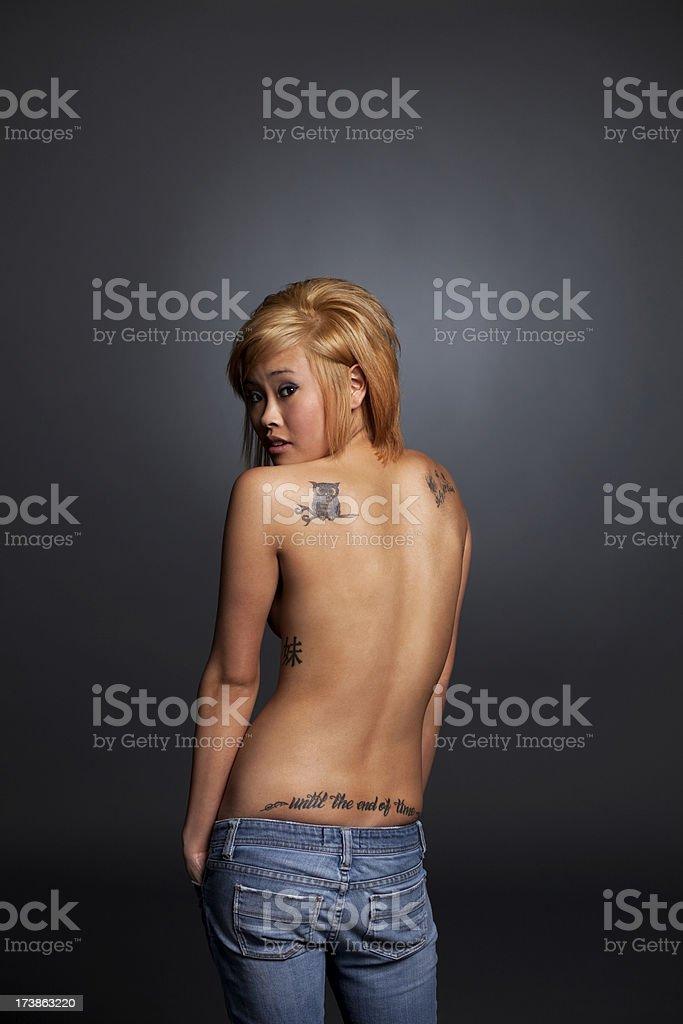 beautiful asian  woman with  tattoos stock photo
