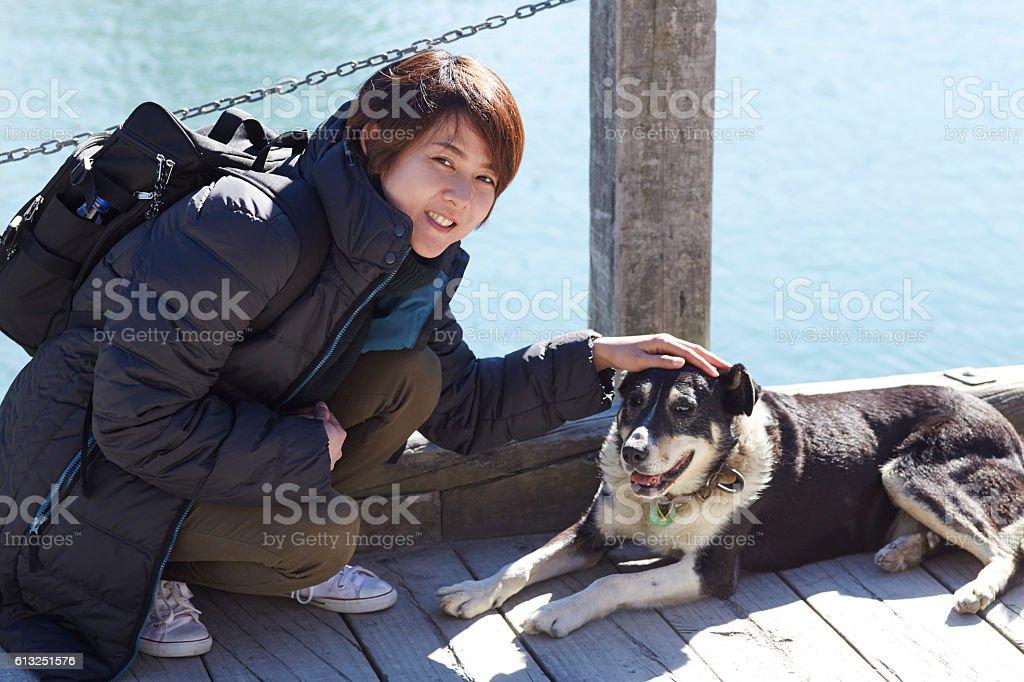 Beautiful Asian women and sheep dog at Port on Lake stock photo