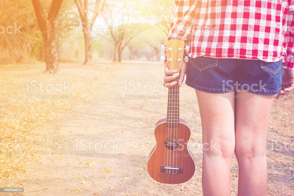 Beautiful asian women holding ukulele guitar at outdoor stock photo