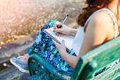 Beautiful asian women with pen writing notebook