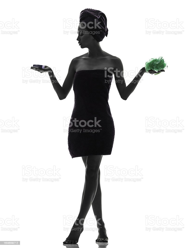beautiful asian young woman holding washing accessories wrapped towel silhouette royalty-free stock photo