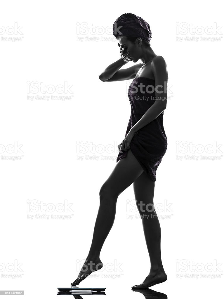 beautiful asian young woman wrapped towel standing weight scale silhouette royalty-free stock photo