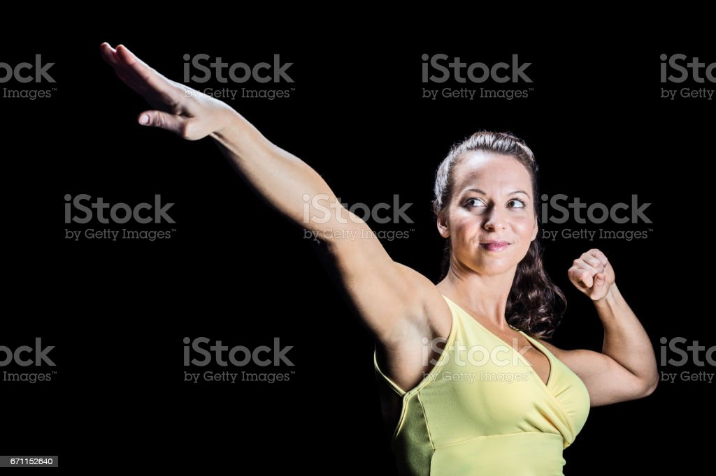 Beautiful athlete stretching hands stock photo