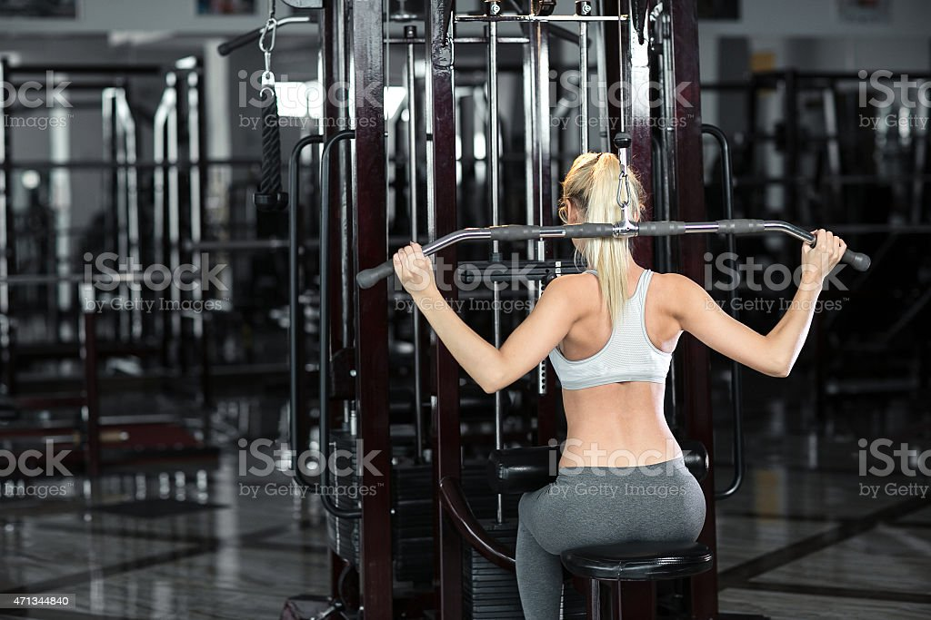 Beautiful athletic girl  poses in the gym stock photo
