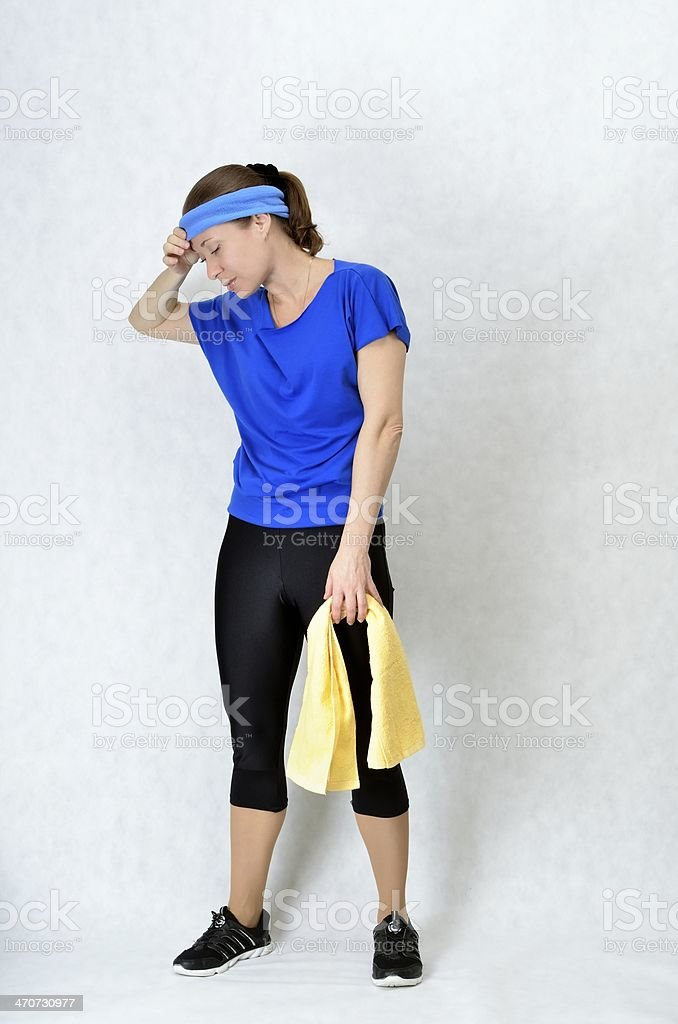 Beautiful athletic girl resting after workout stock photo