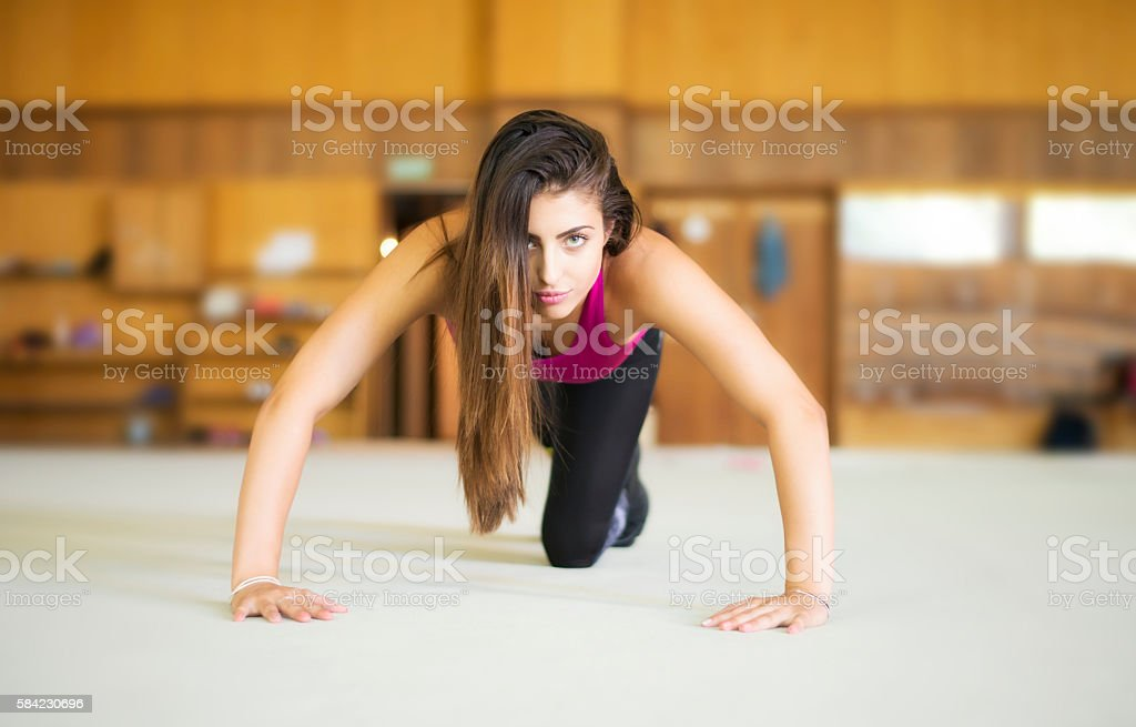 Beautiful athletic woman pushed from the floor stock photo