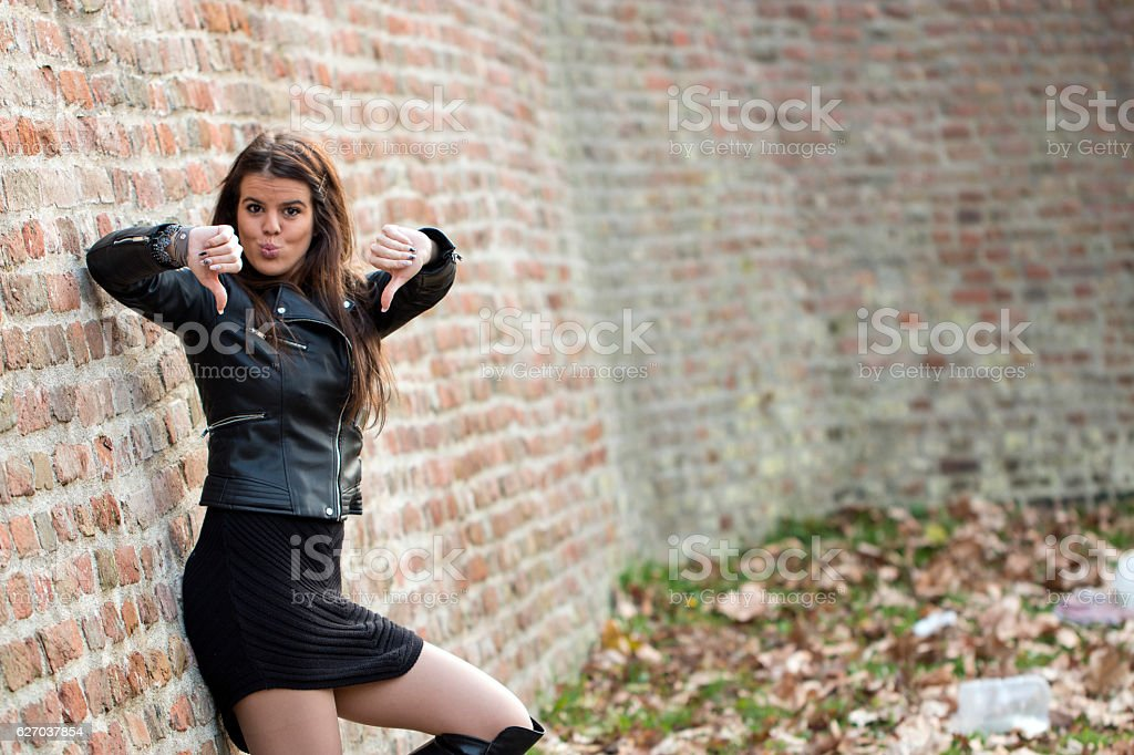 Beautiful attractive girl shows two thumbs down stock photo