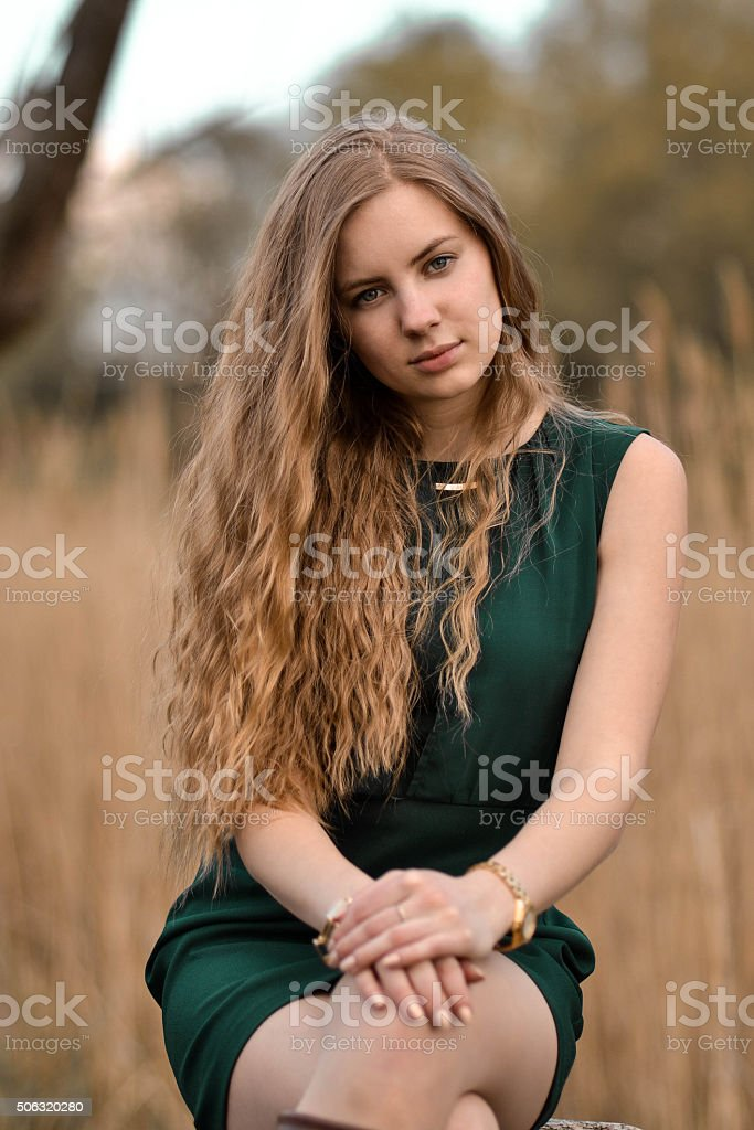 Beautiful, attractive, lovely, cute, girl,woman with curly long hair. stock photo