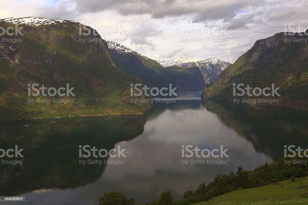 Beautiful Aurland fjord mountain reflection at sunrise, Norway stock photo