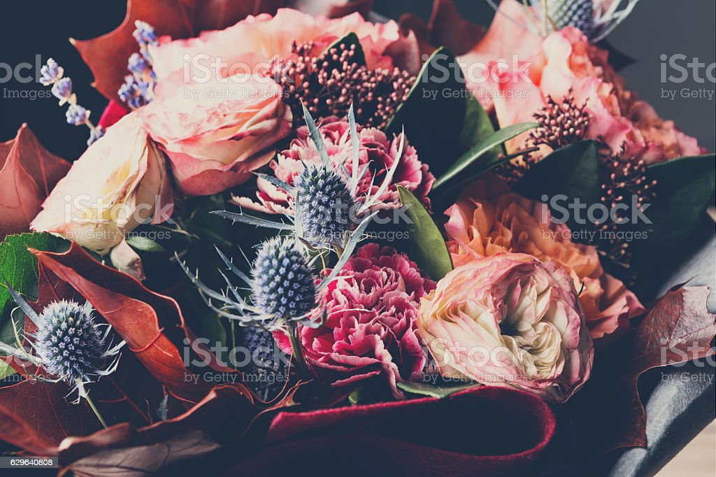 Beautiful autumn bouquet composition of dried meadow flowers and leaves stock photo