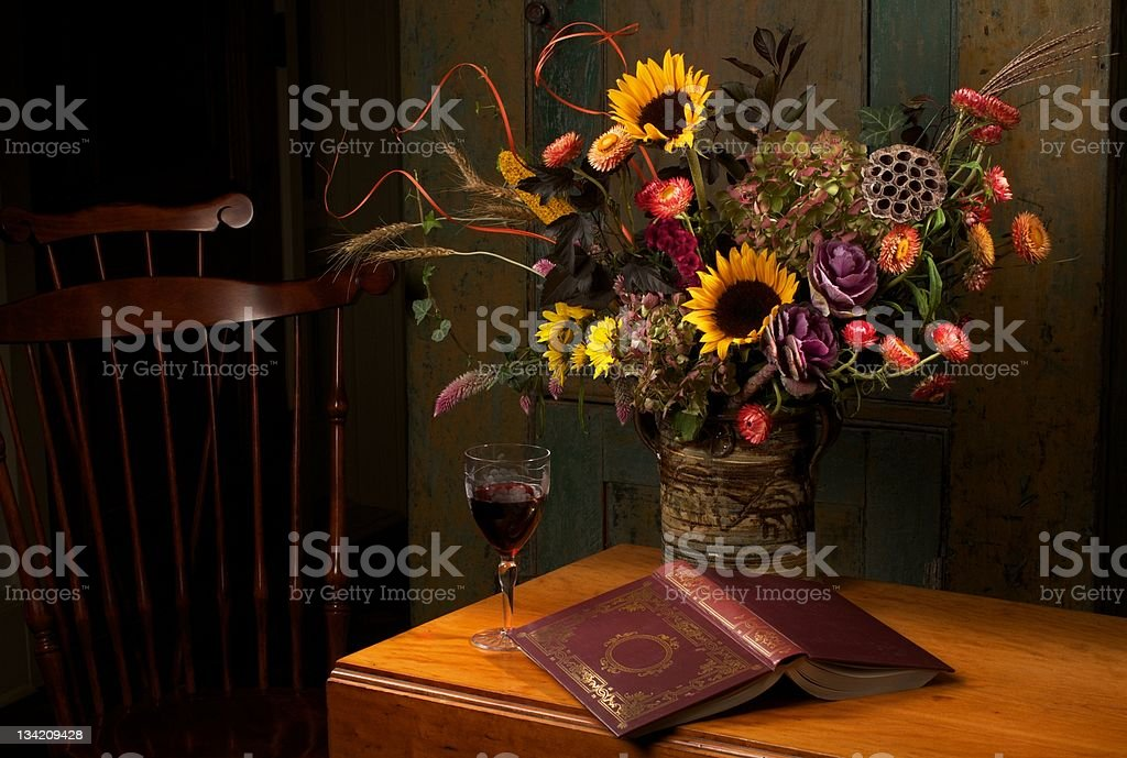 Beautiful autumn floral still life in dark rich colors stock photo