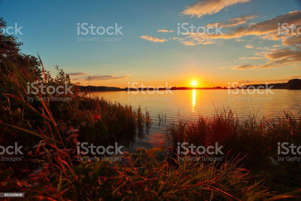 Beautiful autumn sunset over lake in Russia stock photo