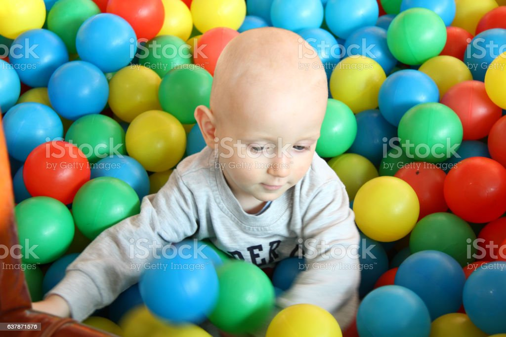 Beautiful baby boy playing at playland stock photo