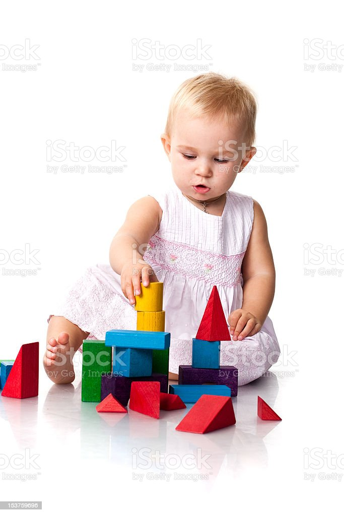 Beautiful baby building a castle stock photo