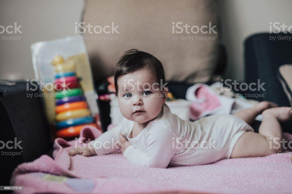 Beautiful baby girl on pink blanket stock photo
