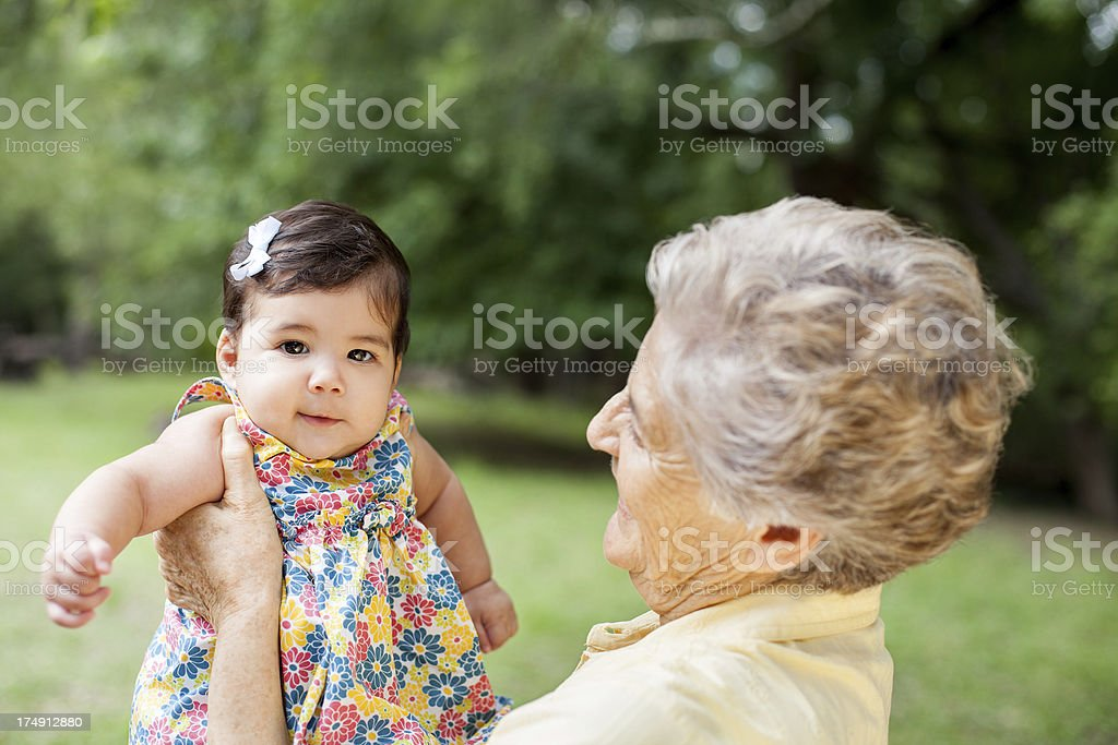 Beautiful baby girl with grandmother royalty-free stock photo