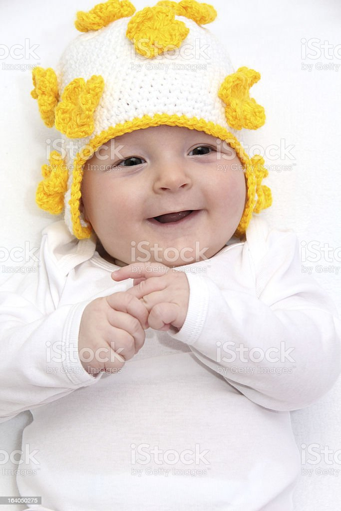 Beautiful baby in knitted hat royalty-free stock photo