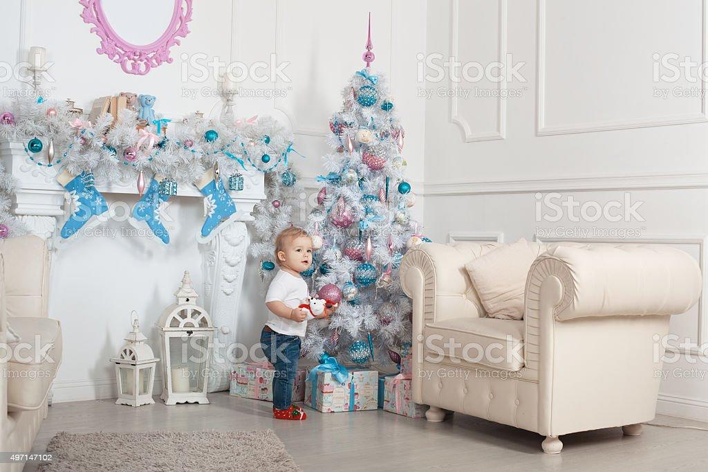 Beautiful baby near a Christmas tree stock photo
