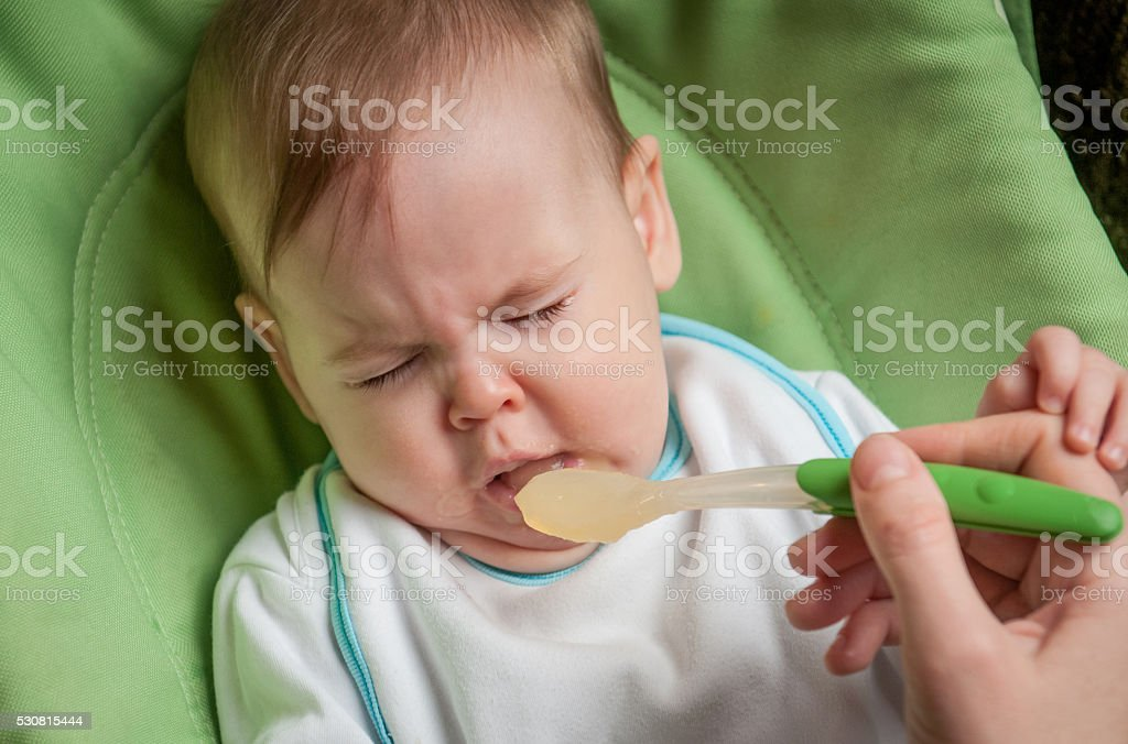 Beautiful baby refuses to eat stock photo