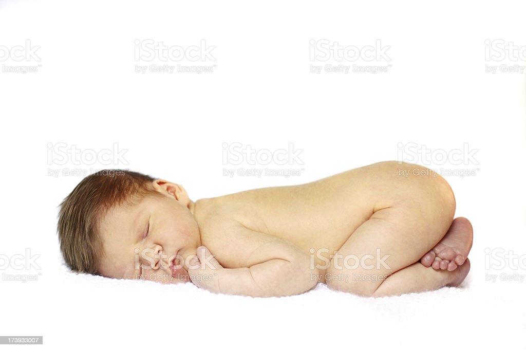 Beautiful baby sleeping on tummy stock photo