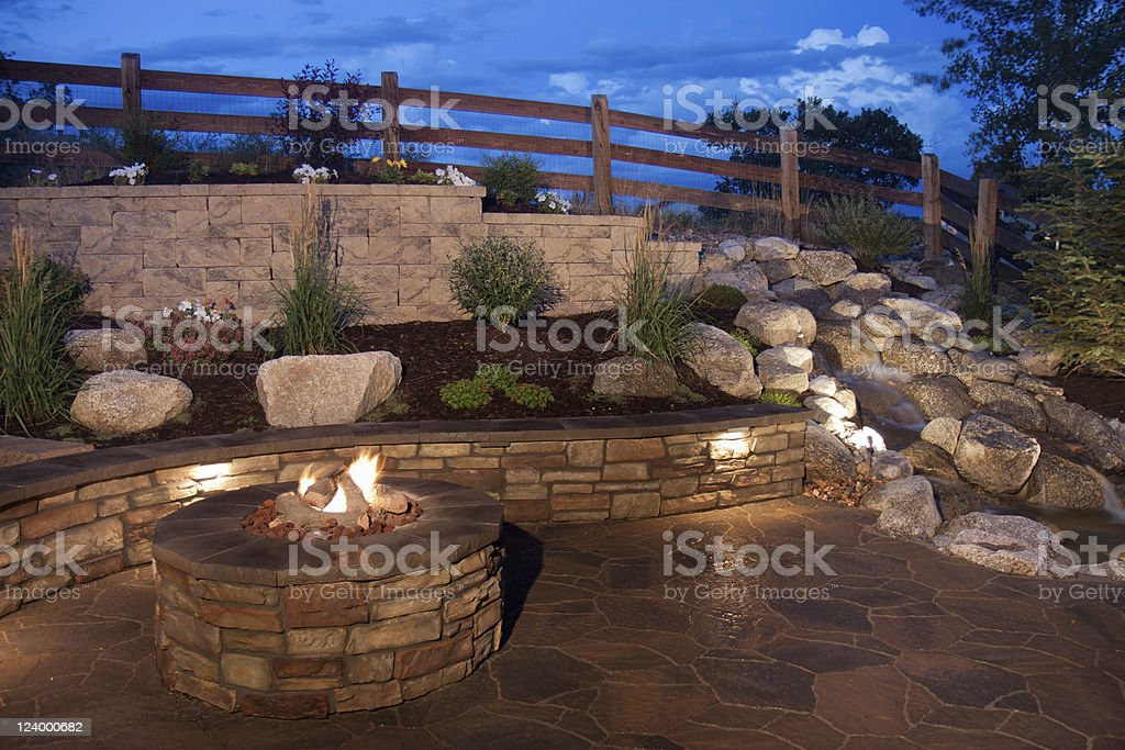 Beautiful Backyard Fire Pit and Seat Wall stock photo