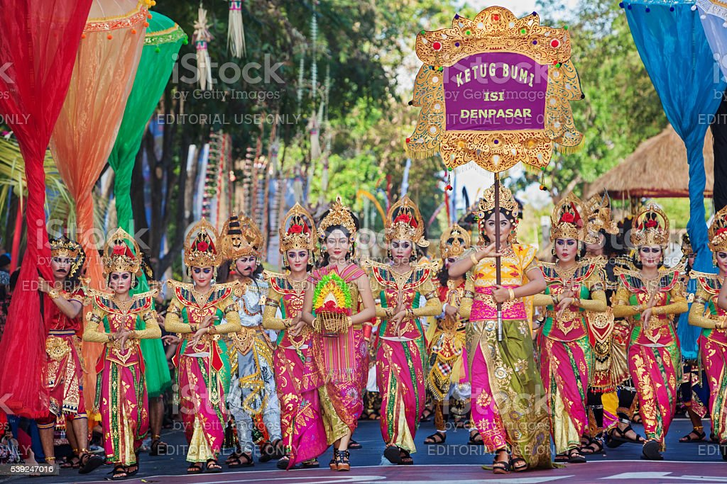 Beautiful Balinese people group in colorful sarongs on parade stock photo