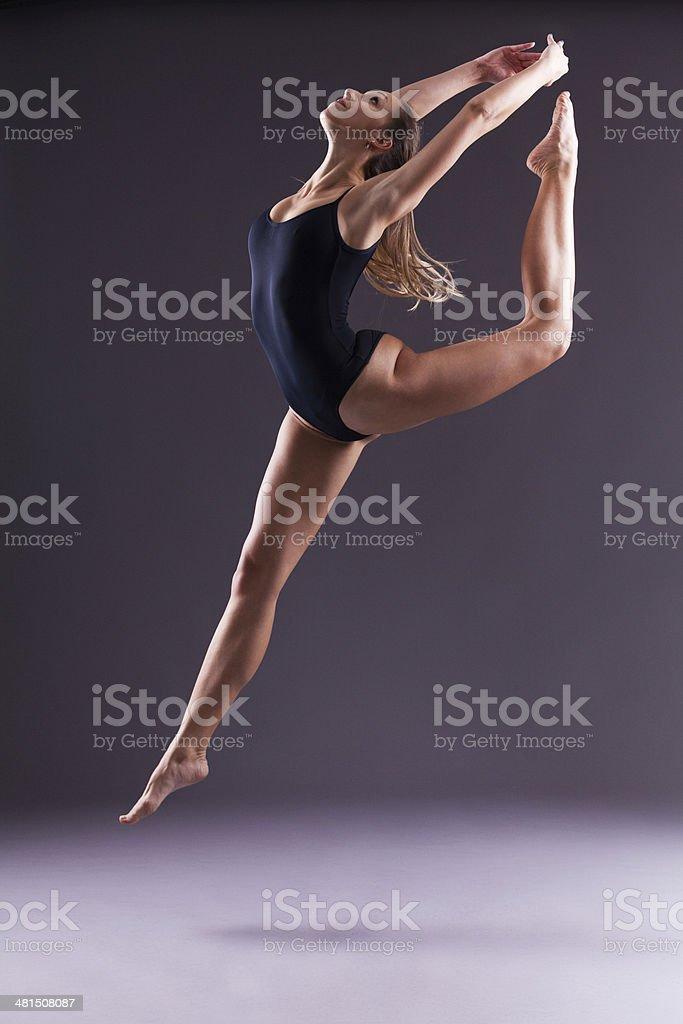Beautiful ballerina jumping and dancing stock photo