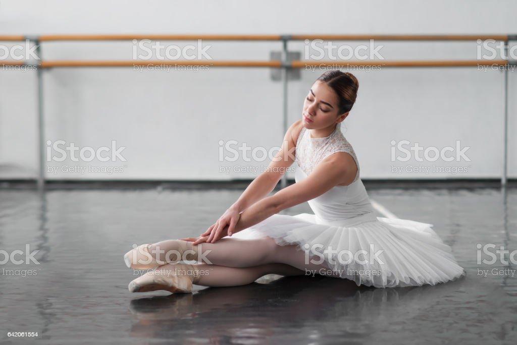 Beautiful ballerina posing in ballet class stock photo