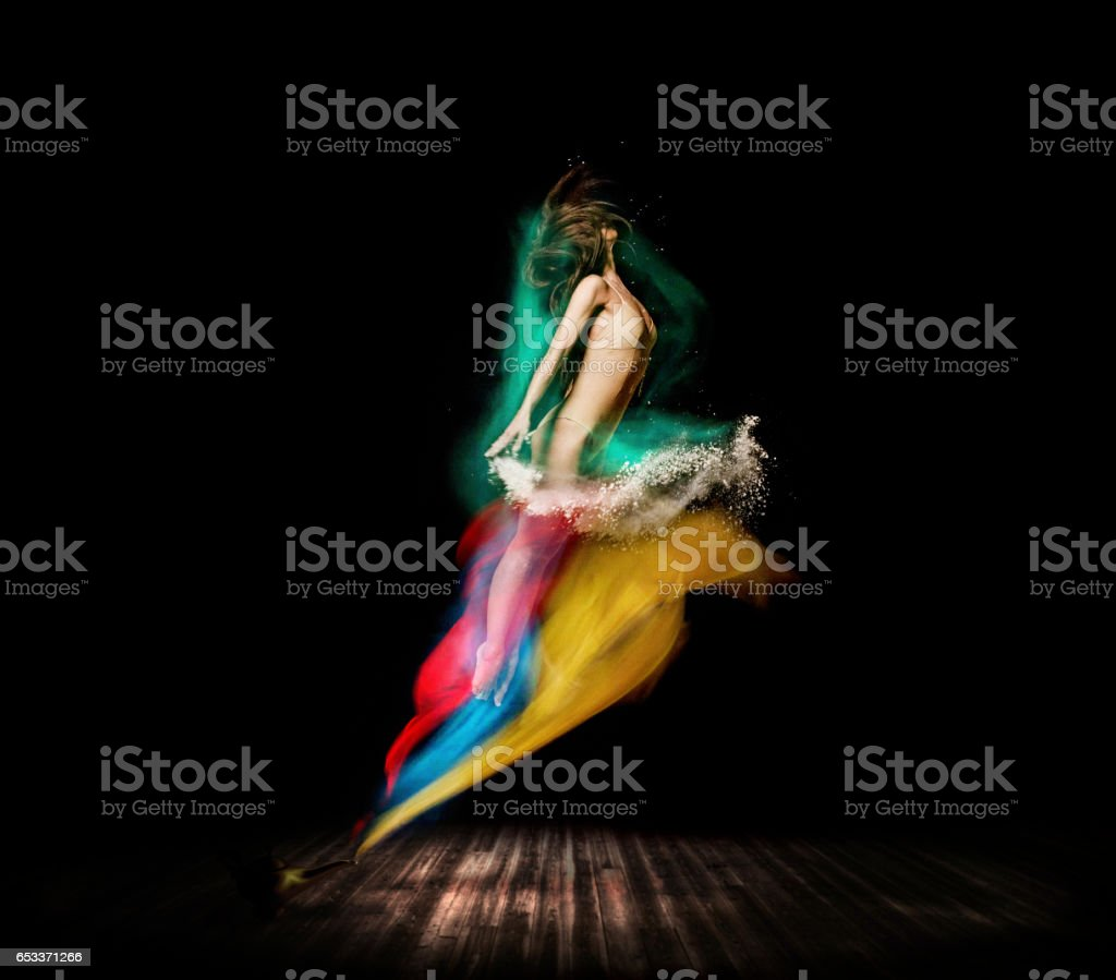 Beautiful ballet dancer, appear from magic lamp on stage stock photo