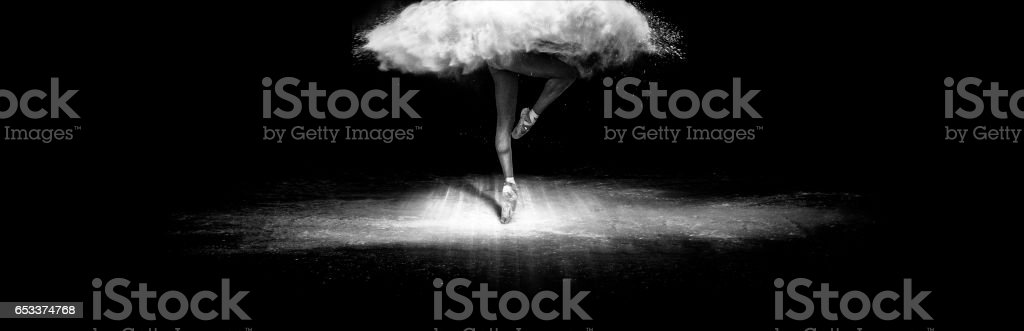 Beautiful ballet dancer, dancing with face powder on stage stock photo