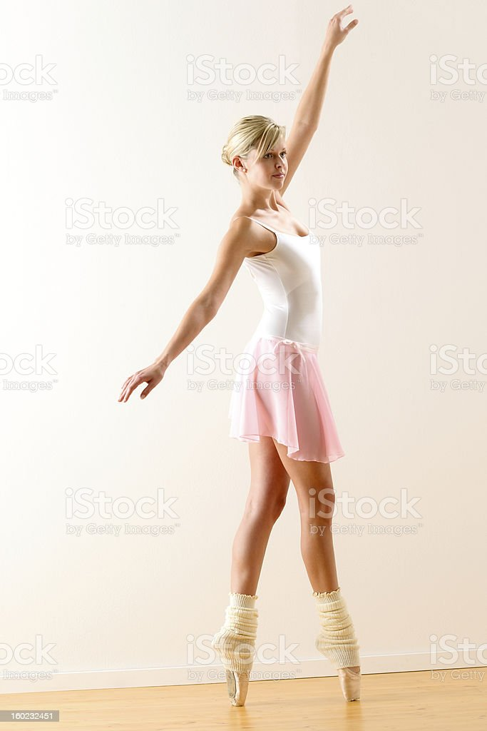 Beautiful ballet dancer practicing dance posture royalty-free stock photo