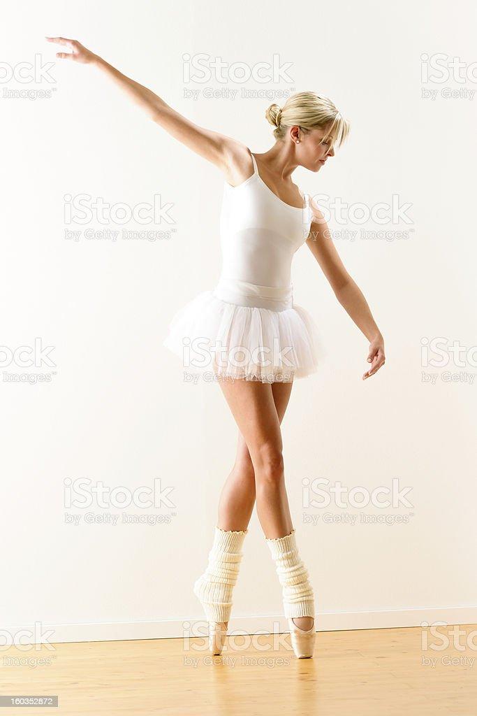 Beautiful ballet dancer practicing dance posture royalty-free stock photo