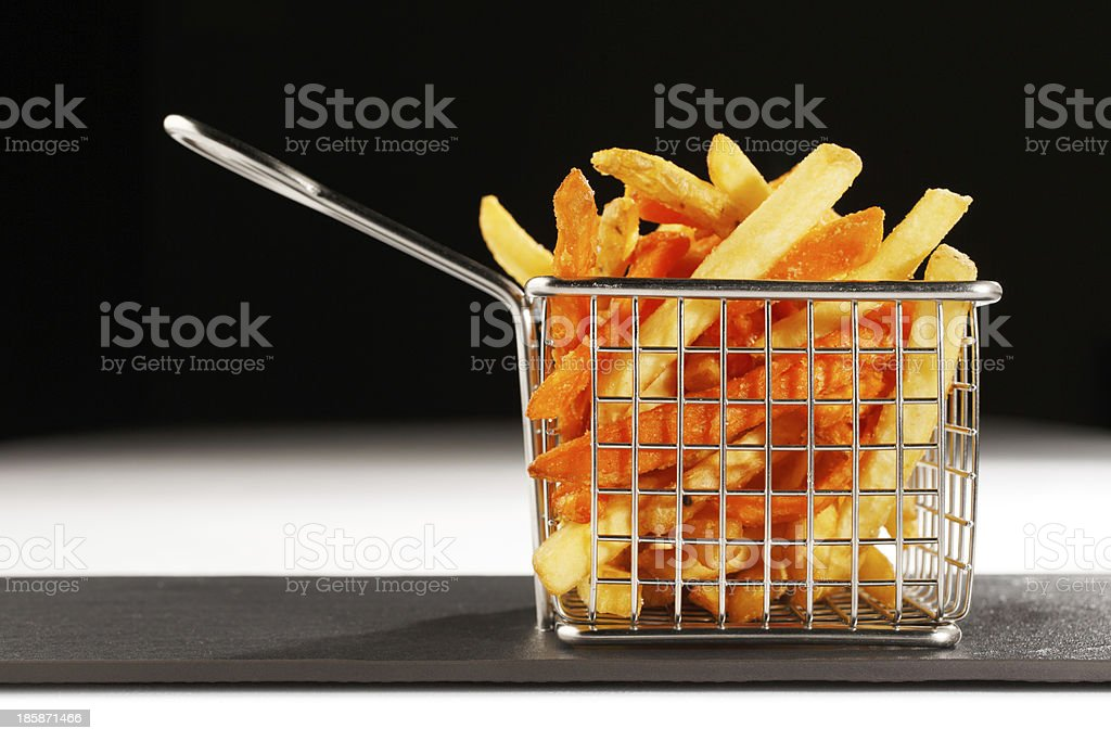beautiful basket of fried chips also known as French Fries stock photo