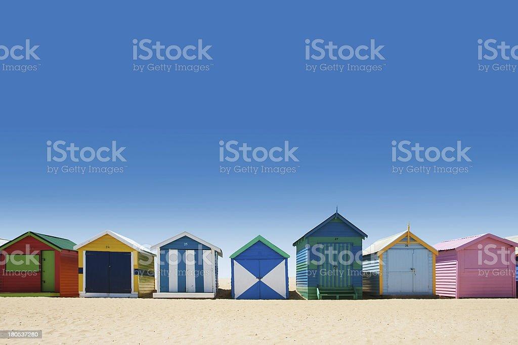 Beautiful bathing houses on white sand beach stock photo