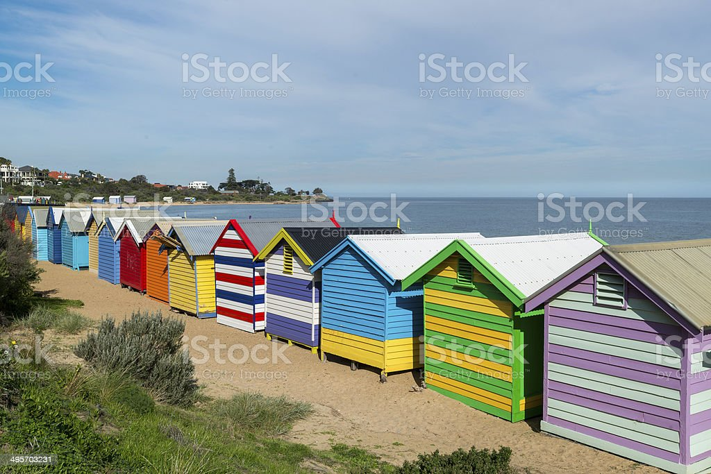 Beautiful Bathing houses on white sandy beach at Brighton beach stock photo
