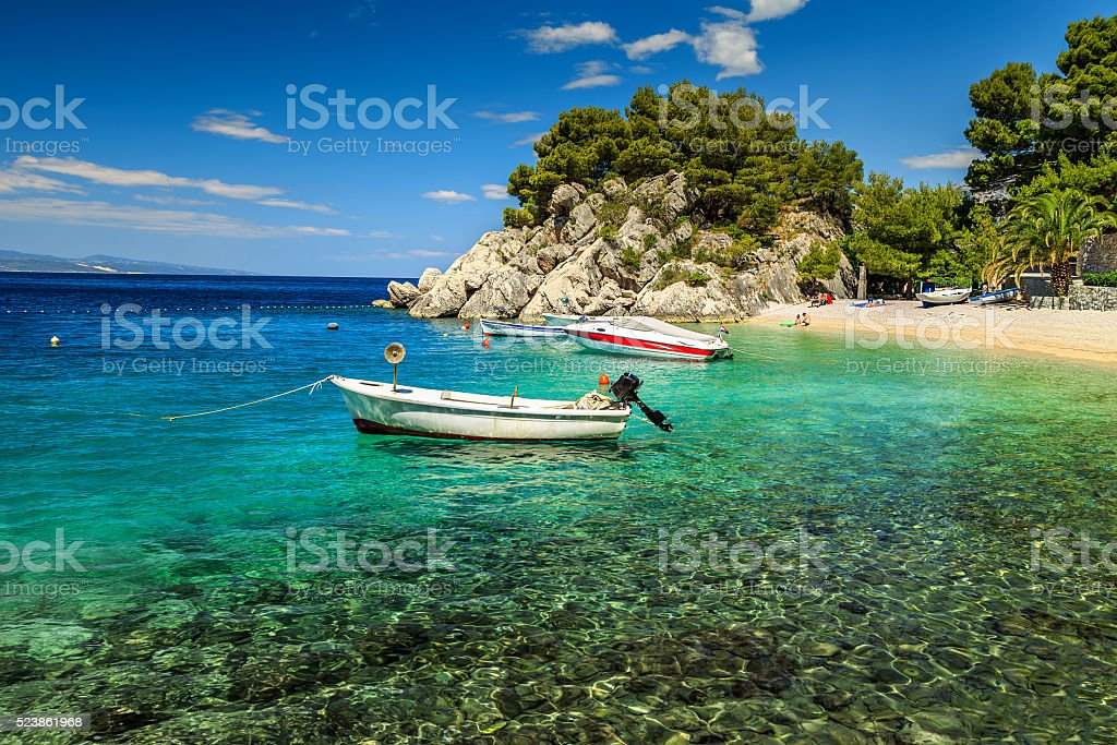 Beautiful bay and beach with motorboats,Brela,Dalmatia region,Croatia stock photo