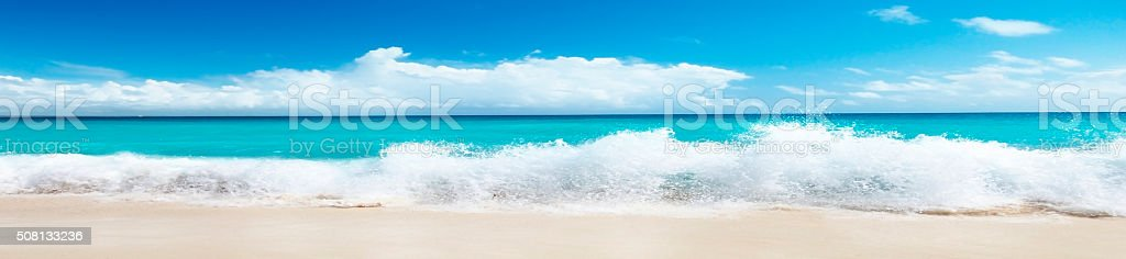 Beautiful beach and sea wave in a panoramic image