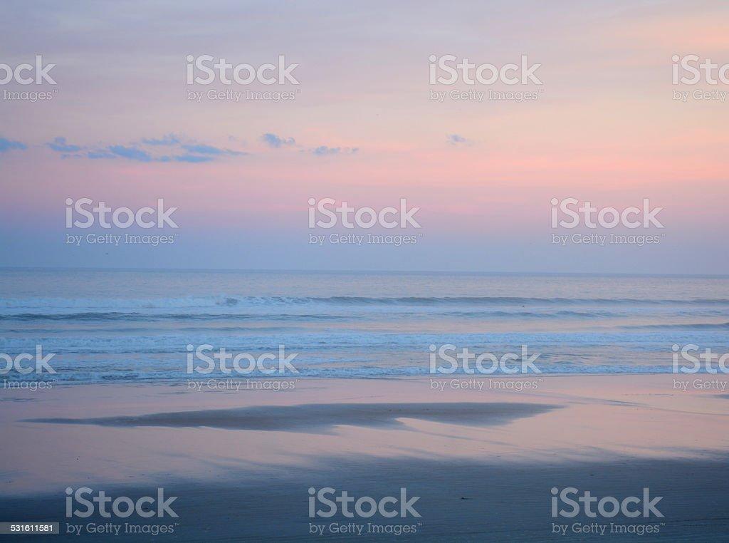 Beautiful beach at sunset. stock photo