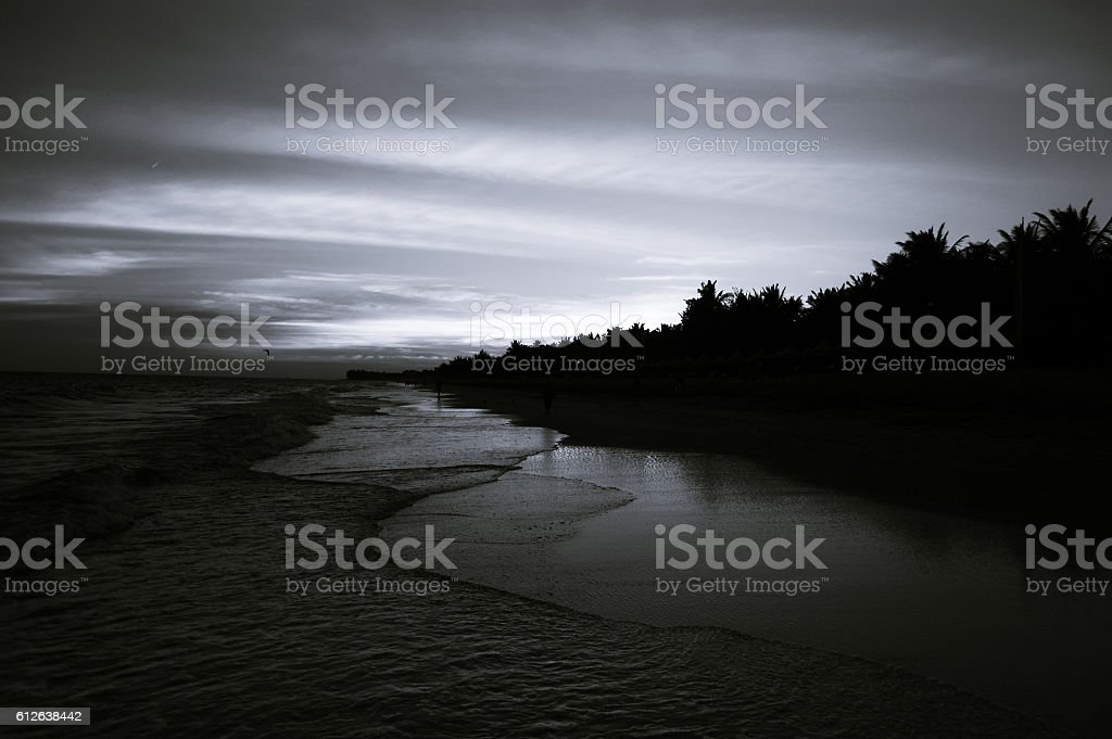Beautiful beach at sunset stock photo