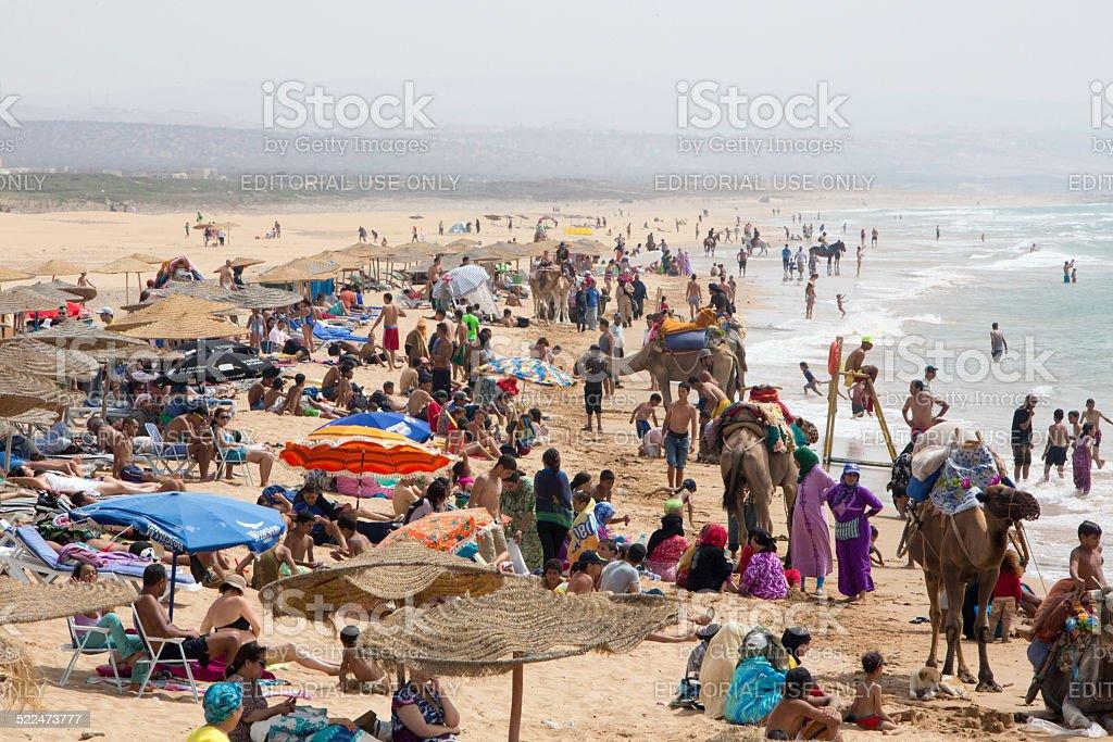 Beautiful beach full of vacationing people, Morocco stock photo
