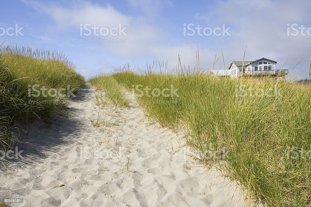 A beautiful beach house surrounded by grasses stock photo