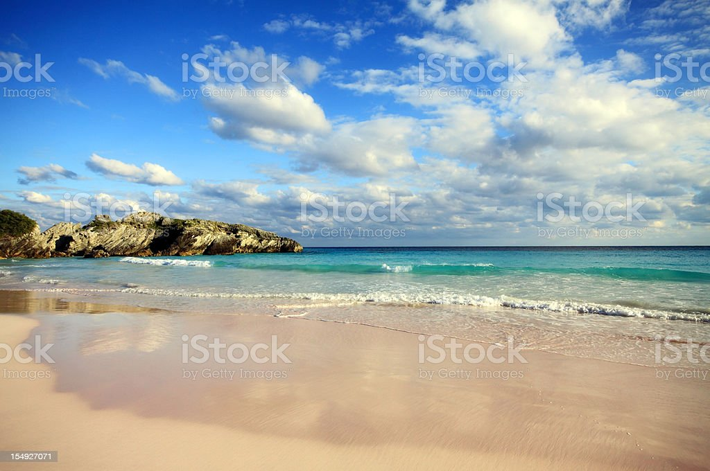 Beautiful beach in Bermuda with blue sea and clouds stock photo
