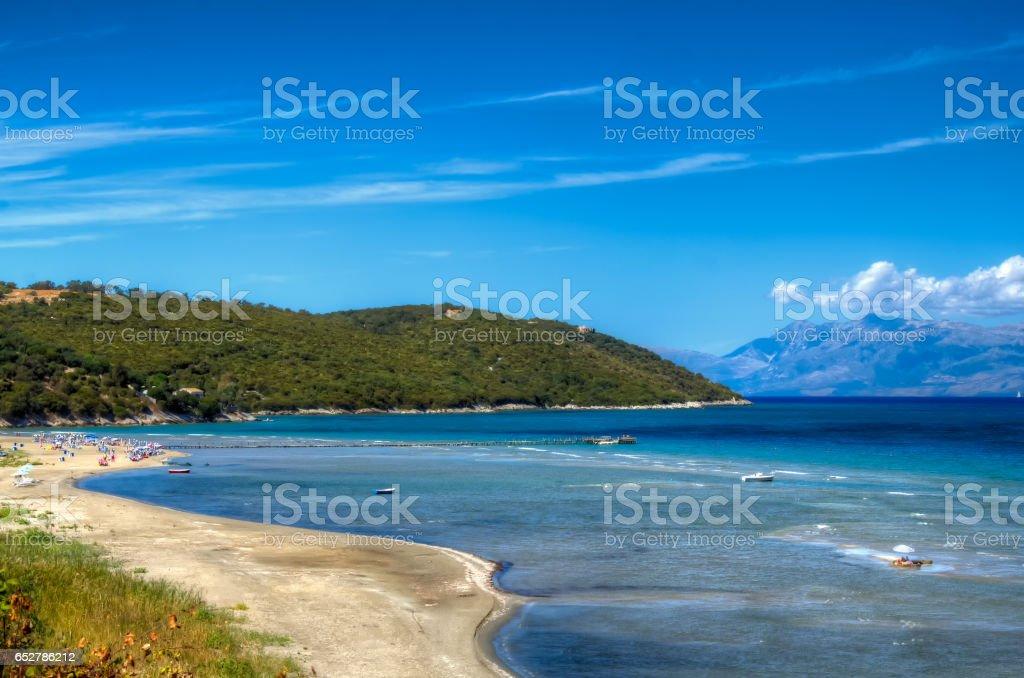 Beautiful beach of the Ionian sea. Family vacation on beach sand. stock photo