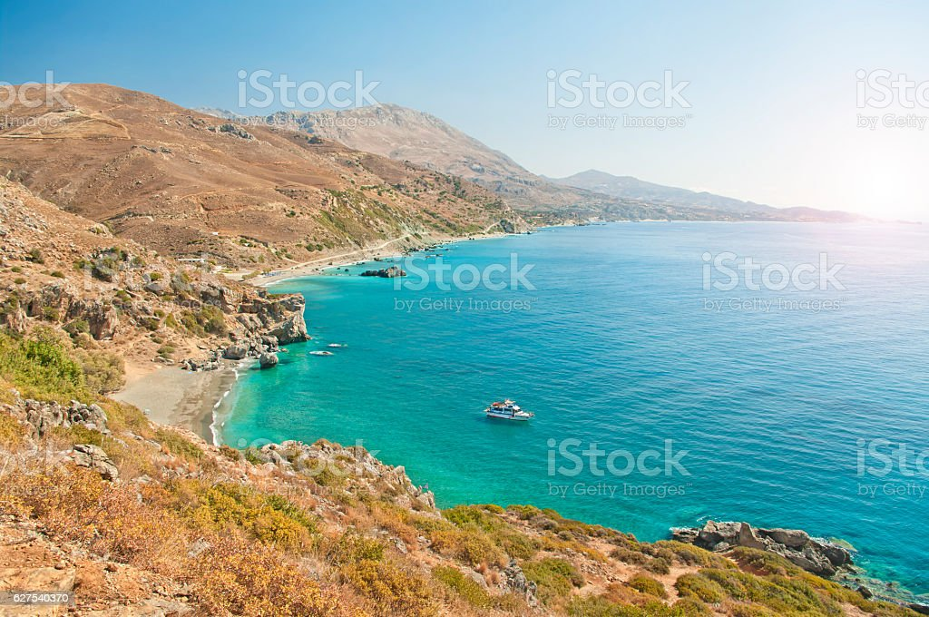 beautiful beach surrounded by mountains from above stock photo