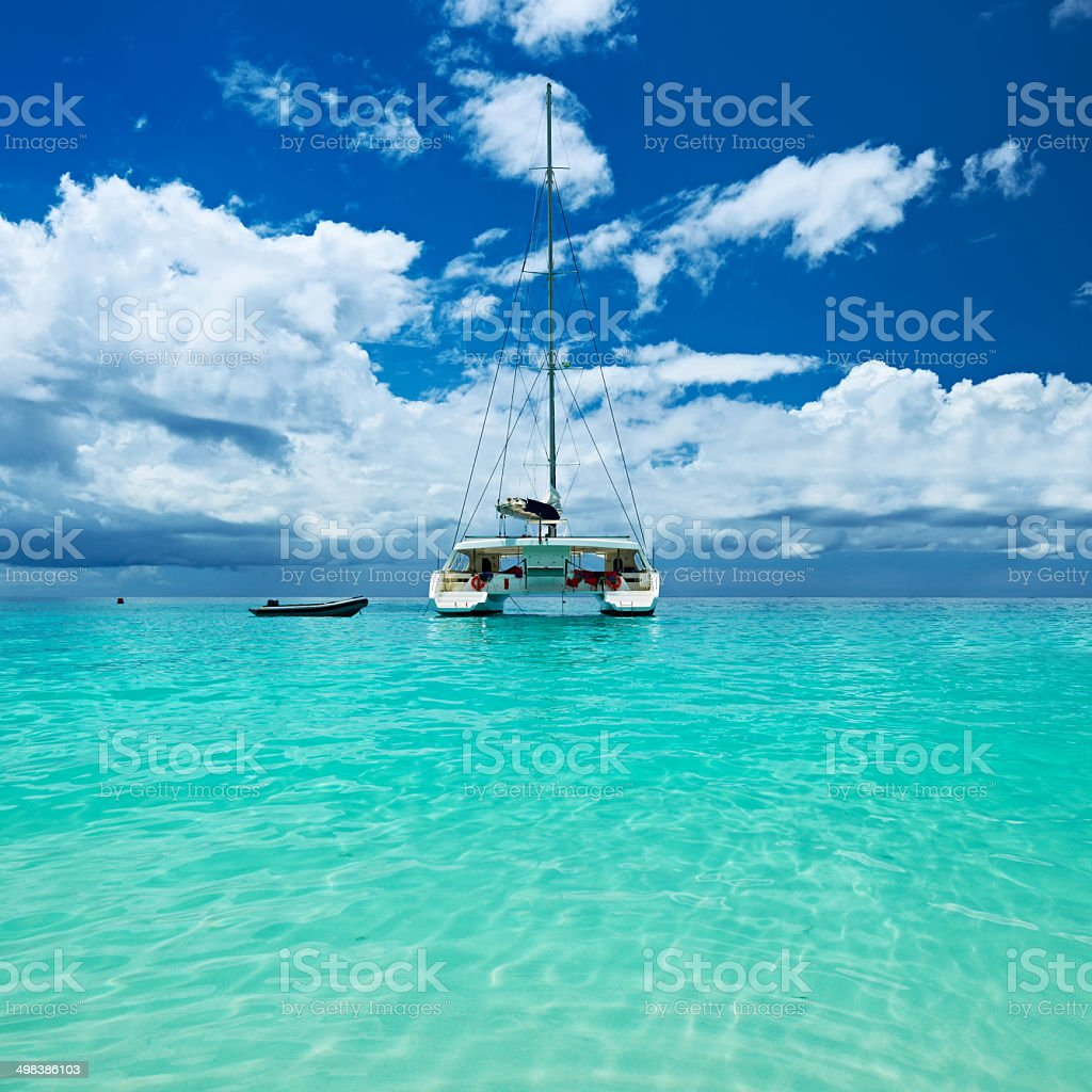 Beautiful beach with boat at Seychelles stock photo