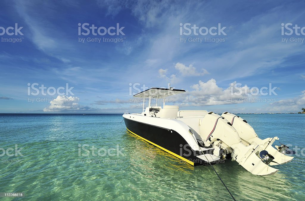Beautiful beach with motor boat royalty-free stock photo