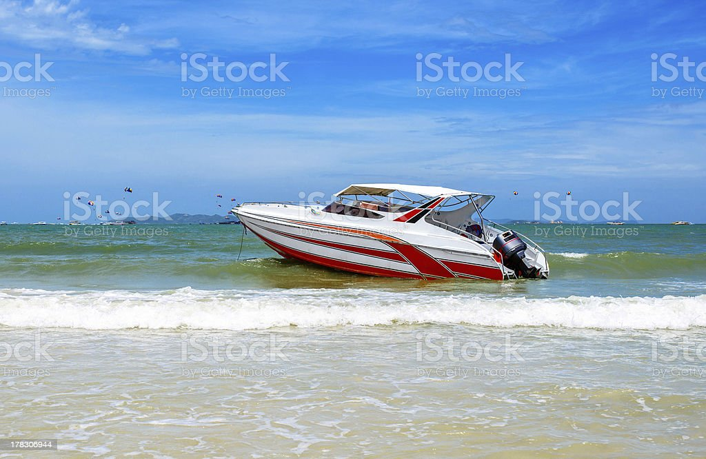 Beautiful beach with motor boat royalty-free stock photo